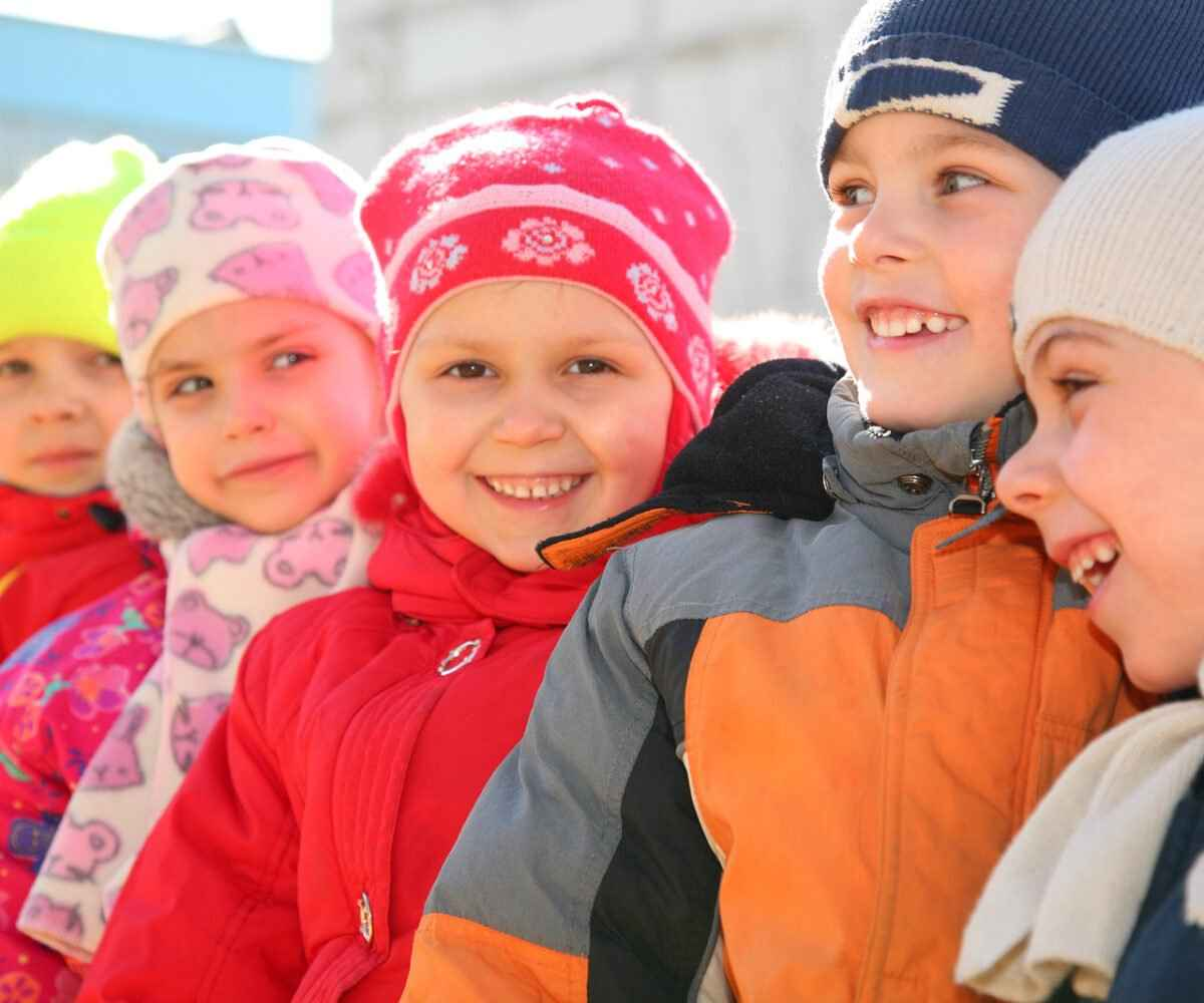 Kids with their friends in warm winter coats