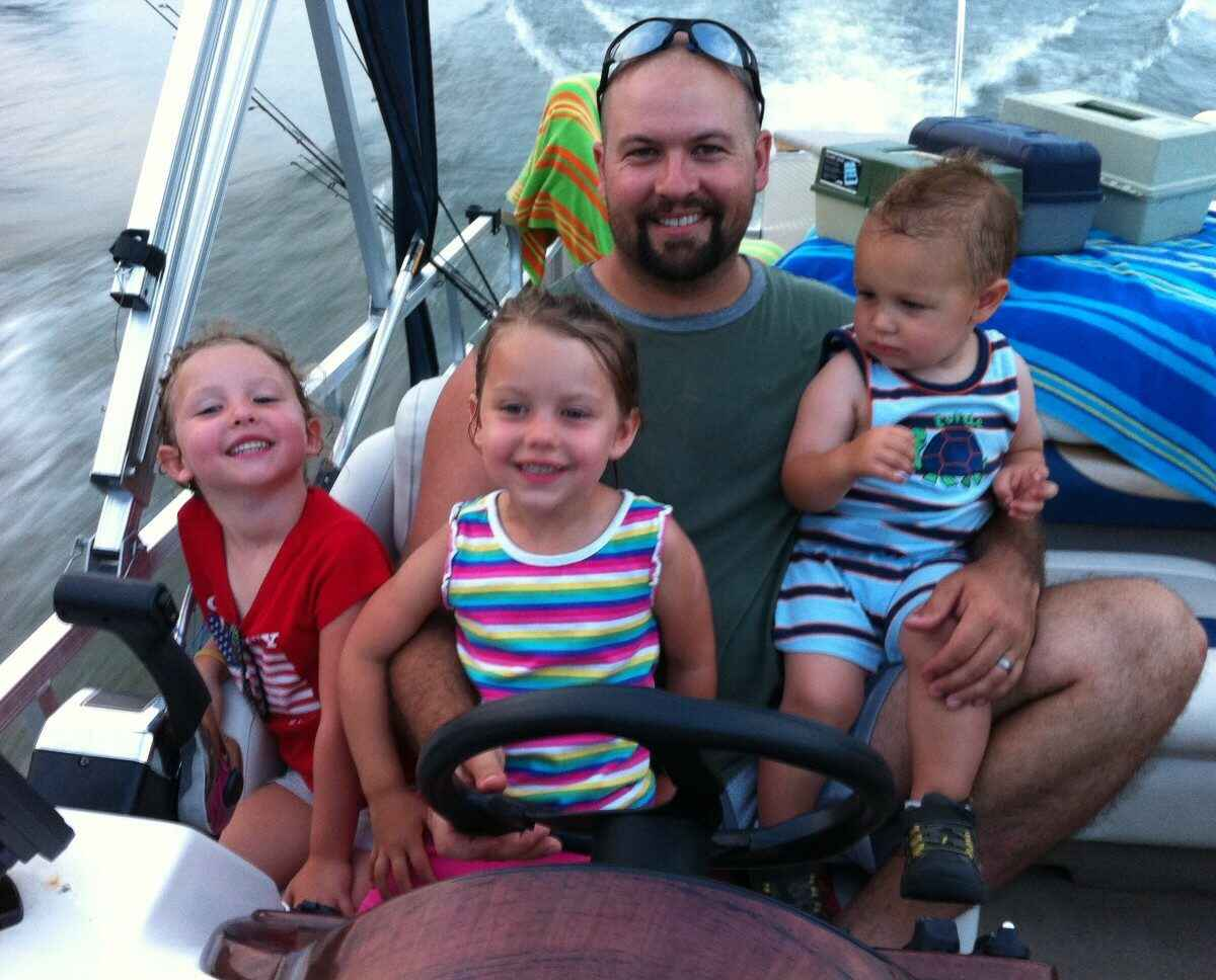 Kids Happy on Boat with Dad
